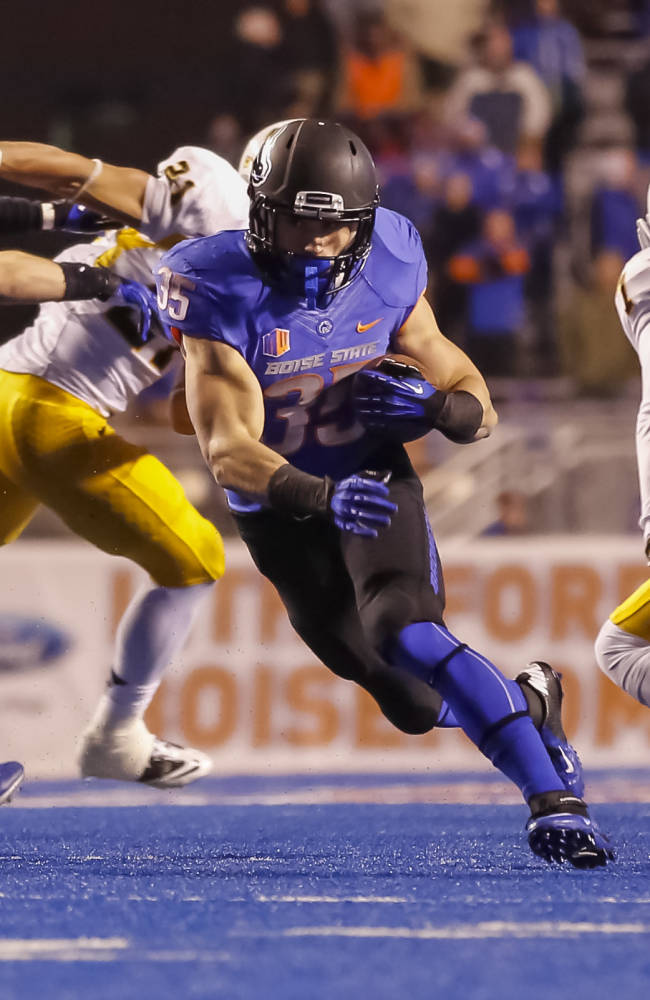Boise State running back Charles Bertoli (35) runs the ball during the second half of an NCAA college football game against Wyoming in Boise, Idaho, Saturday, Nov. 16, 2013. Boise State beat Wyoming 48-7