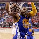 Golden State Warriors forward Andre Iguodala dunks against the Los Angeles Clippers during the first half in Game 2 of an opening-round NBA basketball playoff series in Los Angeles, Monday, April 21, 2014. (AP Photo/Chris Carlson)