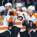 Philadelphia Flyers center Claude Giroux, right, celebrates his goal with teammates during the first period of an NHL hockey game against the Los Angeles Kings, Saturday, Dec. 6, 2014, in Los Angeles The Associated Press