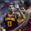 Cleveland Cavaliers forward Tristan Thompson (13) gets a high-five from forward Luol Deng after dunking the ball to take a 86-83 lead over the Detroit Pistons during the fourth quarter of an NBA basketball game Wednesday, Feb. 12, 2014, in Auburn Hills, M