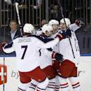 Columbus Blue Jackets players celebrate a goal against the New York Rangers by Matt Calvert during the first period of an NHL hockey game Thursday, Dec. 12, 2013, in New York. (AP Photo/Jason DeCrow)
