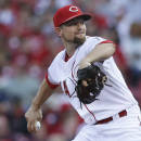 Cincinnati Reds starting pitcher Mike Leake throws in the second inning of a baseball game against the Minnesota Twins, Monday, June 29, 2015, in Cincinnati. (AP Photo/John Minchillo)