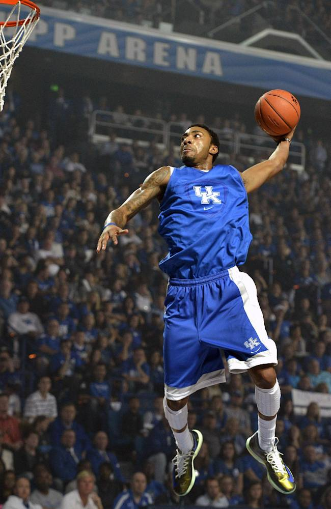 James Young goes up for a slam dunk during action of Kentucky's Big Blue Madness scrimmage Friday, Oct. 18, 2013 in Lexington, Ky