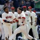 Cleveland Indians' Yan Gomes is congratulated by teammates after hitting a game-winning three-run home run off Seattle Mariners relief pitcher Charlie Furbush in the 10th inning of a baseball game, Monday, May 20, 2013, in Cleveland. Michael Brantley and Drew Stubbs scored. The Indians won 10-8 in 10 innings. (AP Photo/Tony Dejak)