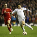 Basel's Behrang Safari, right, runs clear of Liverpool's Jordan Henderson during the Champions League Group B soccer match between Liverpool and FC Basel at Anfield Stadium in Liverpool, England, Tuesday, Dec. 9, 2014