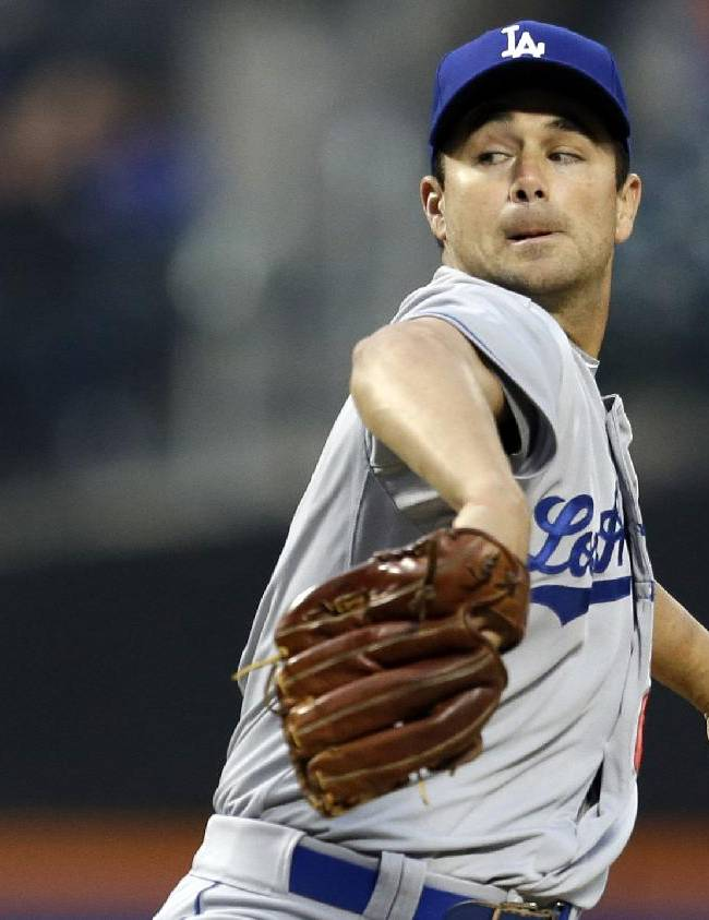 In this April 24, 2013, file photo, Los Angeles Dodgers starting pitcher Ted Lilly winds up against the New York Mets in the first inning of a baseball game at Citi Field in New York. Lilly announced his retirement from baseball on Friday, Nov. 29, 2013, after 15 seasons because of a troublesome shoulder and back