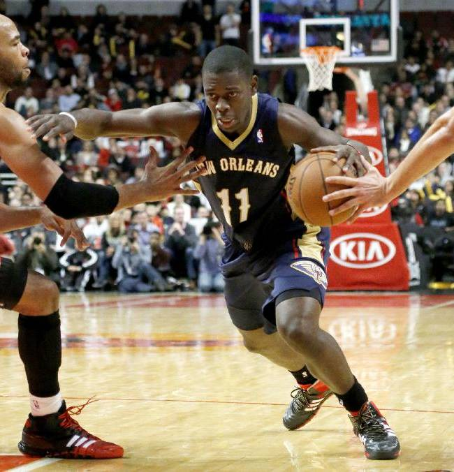 Holiday lifts Pelicans to 3OT win over Bulls