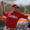 Philadelphia Phillies starting pitcher A.J. Burnett throws in the first inning of an exhibition spring training baseball game against the Baltimore Orioles in Sarasota, Fla., Friday, March 7, 2014 The Associated Press