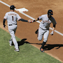 San Francisco Giants' Brandon Belt, right, celebrates his solo home run with Giants third base coach Tim Flannery (1) during the first inning of a baseball game against the Arizona Diamondbacks, Thursday, April 3, 2014, in Phoenix The Associated Press