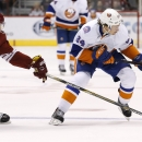 Arizona Coyotes' Connor Murphy (5) pokes the puck away from New York Islanders' Mikhail Grabovski (84) during the first period of an NHL hockey game Saturday, Nov. 8, 2014, in Glendale, Ariz The Associated Press