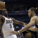 Milwaukee Bucks' Ekpe Udoh goes after a ball in front of San Antonio Spurs' Jeff Ayres during the first half of an NBA basketball game Wednesday, Dec. 11, 2013, in Milwaukee The Associated Press