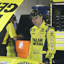 Driver Matt Kenseth looks over his car before a qualifying session for the NASCAR Sprint Cup series Quicken Loans 400 auto race at Michigan International Speedway in Brooklyn, Mich., Saturday, June 14, 2014. (AP Photo/Carlos Osorio)