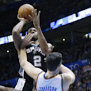 San Antonio Spurs forward Kawhi Leonard (2) fouls Oklahoma City Thunder forward Nick Collison (4) as he shoots in the third quarter of an NBA basketball game in Oklahoma City, Wednesday, Nov. 27, 2013. Oklahoma City won 94-88 The Associated Press