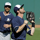 Milwaukee Brewers right fielder Mitch Haniger miss plays a fly ball by Cleveland Indians' Mike Aviles allowing a run to score in the sixth inning of a spring training exhibition baseball game Sunday, March 9, 2014, in Goodyear, Ariz The Associated Press