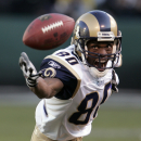 In this Dec. 17, 2006 file photo, St. Louis Rams wide receiver Isaac Bruce (80) eyes the football in the third quarter against the Oakland Raiders during their NFL game in Oakland, Calif. Super Bowl-winning quarterback Kurt Warner and linebacker Junior S