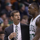 Boston Celtics head coach Brad Stevens has a word with Boston Celtics power forward Brandon Bass (30) as Stevens sits him during the first half of their NBA basketball game against the Dallas Mavericks in Boston, Sunday, Feb. 9, 2014 The Associated Press
