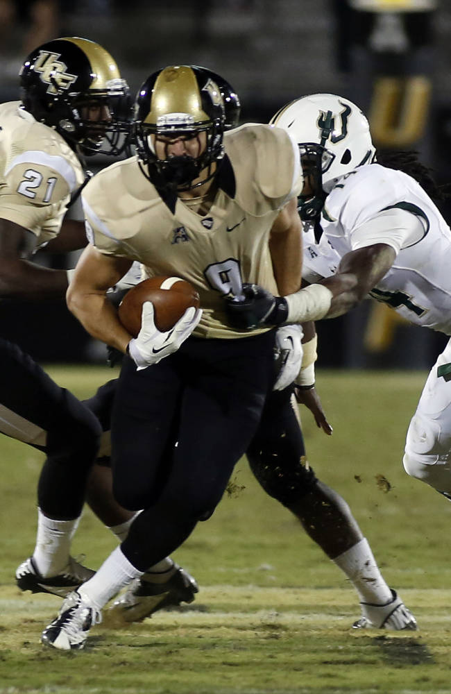 No. 17 UCF survives scare from rival USF, 23-20