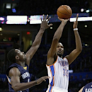 Oklahoma City Thunder forward Kevin Durant (35) shoots as Memphis Grizzlies guard Tony Allen (9) defends during the fourth quarter of Game 1 of the opening-round NBA basketball playoff series in Oklahoma City on Saturday, April 19, 2014. Oklahoma City won