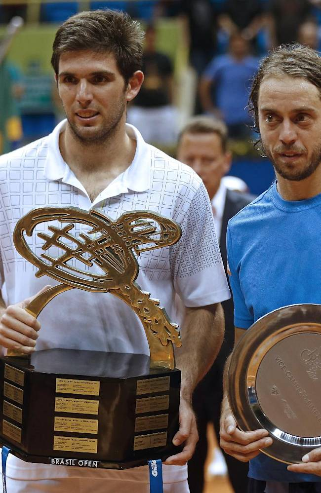Argentina's Federico Delbonis, left, and Italy's Paolo Lorenzi, hold their trophies as they pose for pictures at the end of their Brazil Open ATP final tennis match in Sao Paulo, Brazil, Sunday, March 2, 2014. Delbonis won the open