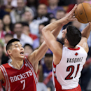 Toronto Raptors guard Greivis Vasquez (21) shoots past Houston Rockets guard Jeremy Lin (7) during second-half NBA basketball action in Toronto, Wednesday, April 2, 2014 The Associated Press