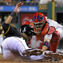 Pittsburgh Pirates' Pedro Alvarez, left, slides safely around the attempted tag by St. Louis Cardinals catcher Yadier Molina during the sixth inning of a baseball game in Pittsburgh on Friday, April 4, 2014 The Associated Press