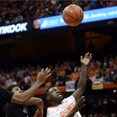 Syracuse's Kaleb Joseph, right, attempts to reclaim a layup that he missed during the first half of an NCAA college basketball game against Holy Cross at the Carrier Dome in Syracuse, N.Y., Friday, Nov. 28, 2014. (AP Photo/Heather Ainsworth)