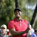 Tiger Woods watches his tee shot on the 12th hole during the final round of the Cadillac Championship gol</td></tr>