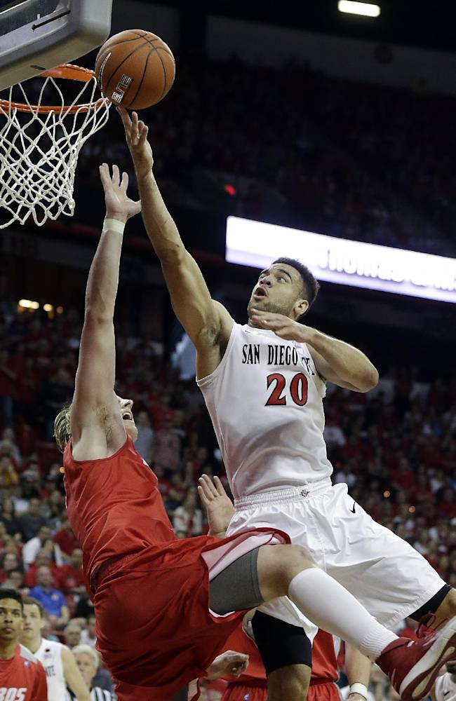 New Mexico's Cameron Bairstow, front left, covers a shot from San Diego State's JJ O'Brien during the second half of an NCAA college basketball game for the Mountain West Conference tournament championship on Saturday, March 15, 2014, in Las Vegas. New Mexico defeated San Diego State 64-58