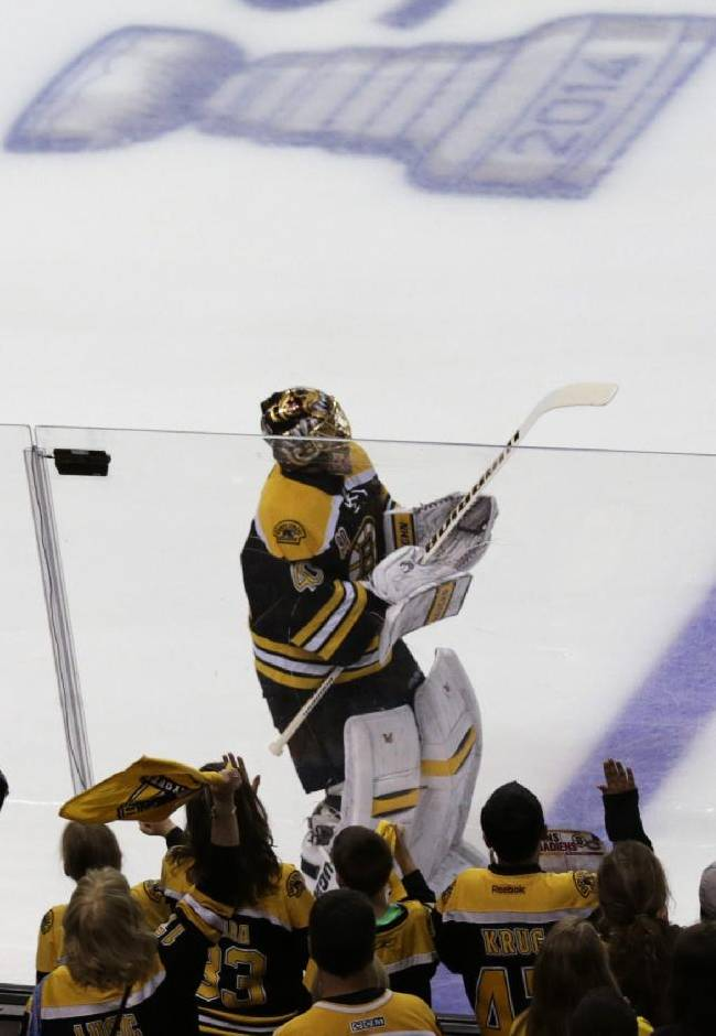 Boston Bruins fans cheer as goalie Tuukka Rask skates during a warmup before facing the Montreal Canadiens in Game 5 of the second-round of the Stanley Cup hockey playoff series in Boston, Saturday, May 10, 2014