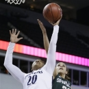 Penn State guard Alex Bentley, left, battles for a rebound with Michigan State guard Klarissa Bell during the first half of an NCAA college basketball game in the Big Ten Conference tournament in Hoffman Estates, Ill., on Saturday, March 9, 2013. (AP Photo/Nam Y. Huh)