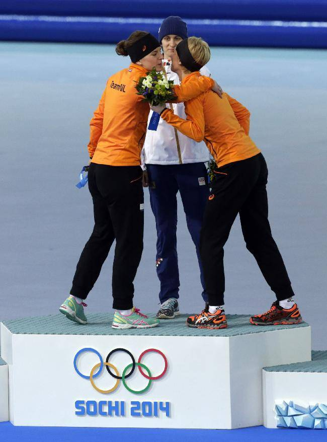 Silver medallist Ireen Wust of the Netherlands, left, congratulates bronze medallist Carien Kleibeuker of the Netherlands, right, watched by gold medallist Martina Sablikova of the Czech Republic during the flower ceremony for the women's 5,000-meter speedskating race at the Adler Arena Skating Center during the 2014 Winter Olympics in Sochi, Russia, Wednesday, Feb. 19, 2014