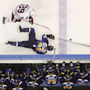 St. Louis Blues defenseman Kevin Shattenkirk (22) continues to battle for the puck after slipping to the ice against Chicago Blackhawks left wing Bryan Bickell in the second period of Game 2 of a first-round NHL hockey playoff series on Saturday, April 19