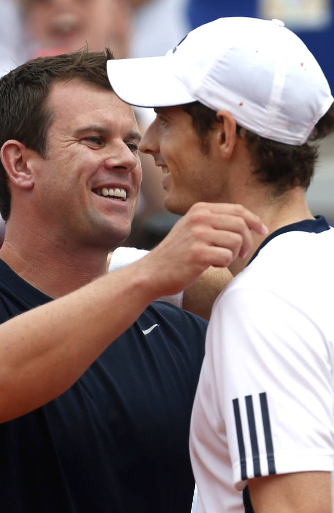 Britain's Andy Murray, right, with Britain's team Captain Leon Smith, celebrates his victory over Croatia's Ivan Dodig Davis Cup play-off tennis match in Umag, Croatia, Sunday, Sept. 15, 2013