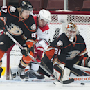 Ducks' goaltender Frederik Andersen keeps an eye on the puck as Hampus Lindholm battles with Eric Staal during the first period of their hockey game at Honda Center Tuesday night Feb. 3, 2015 The Associated Press
