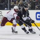 Los Angeles Kings defenseman Drew Doughty (8) and Phoenix Coyotes forward Brandon Mcmillan (38) vie for the puck during the first period of an NHL hockey game, Wednesday, April 2, 2014, in Los Angeles The Associated Press