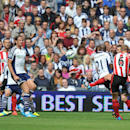 Sunderland's Lee Cattermole, third right, scores his side's opening goal during their English Premier League soccer match against West Bromwich Albion at The Hawthorns, West Bromwich, England, Saturday, Aug. 16, 2014
