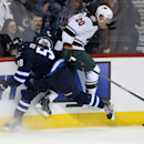 Winnipeg Jets' Eric O'Dell (58) collides with Minnesota Wild's Ryan Suter (20) during third period NHL hockey action in Winnipeg, Manitoba, Monday, April 7, 2014 The Associated Press