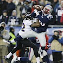 New England Patriots strong safety Duron Harmon (30) intercepts a pass by Baltimore Ravens quarterback Joe Flacco in front of Baltimore Ravens wide receiver Torrey Smith (82) in the second half of an NFL divisional playoff football game Saturday, Jan. 10,