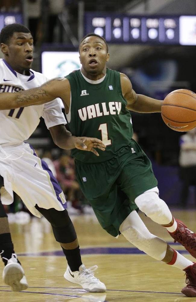 Mississippi Valley State guard DeAngelo Priar, right, tries to drive past Washington's Mike Anderson in the first half of an NCAA men's basketball game, Friday, Dec. 27, 2013, in Seattle