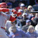 Cincinnati Reds' Billy Hamilton hits an RBI double against the Chicago Cubs during the fifth inning of a baseball game in Chicago, Friday, April 18, 2014 The Associated Press