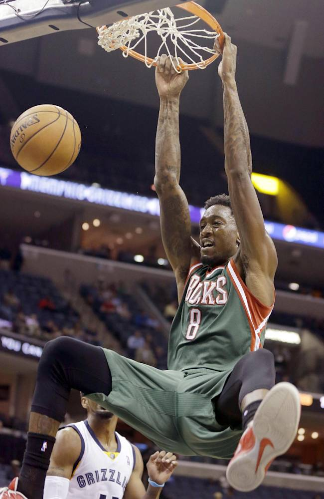 Milwaukee Bucks center Larry Sanders dunks the ball during the first half of an NBA preseason basketball game against the Memphis Grizzlies in Memphis, Tenn., Tuesday, Oct. 15, 2013