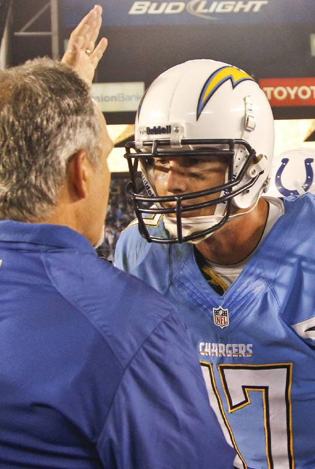 Indianapolis Colts coach Chuck Pagano congratulates San Diego Chargers quarterback Philip Rivers after the Chargers 19-9 victory in a NFL football game  Monday, Oct. 14, 2013, in San Diego