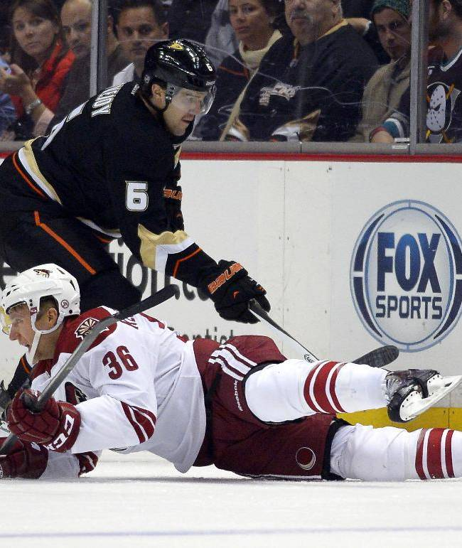 Phoenix Coyotes left wing Rob Klinkhammer, below, falls as Anaheim Ducks defenseman Ben Lovejoy passes the puck during the first period of an NHL hockey game Wednesday, Nov. 6, 2013, in Anaheim, Calif