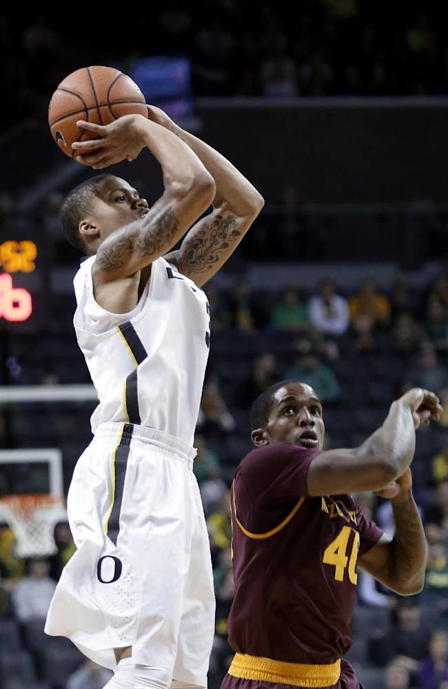 Oregon guard Joseph Young, left, shoots over Arizona State forward Shaquielle McKissic during the first half of an NCAA college basketball game in Eugene, Ore., Tuesday, March 4, 2014