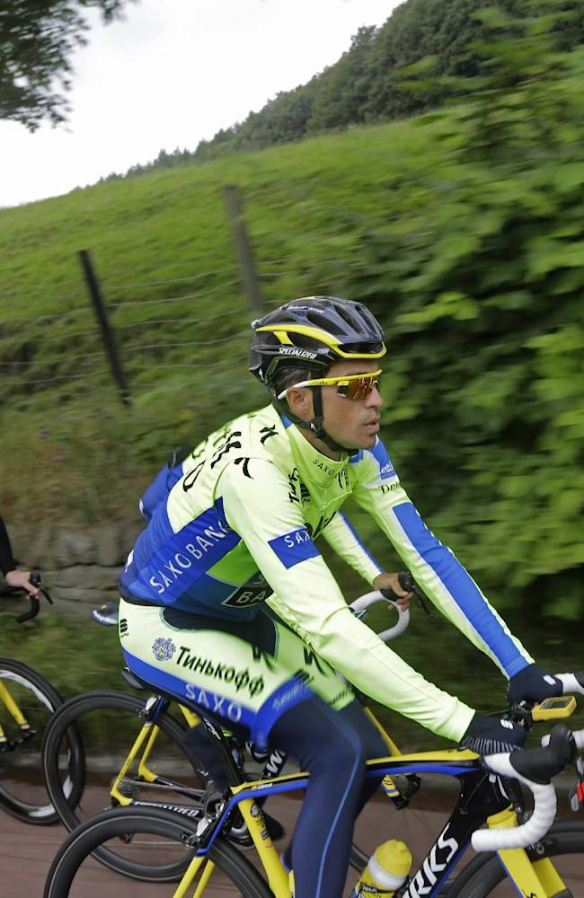 Spain's Alberto Contador follows his teammates during a training ride ahead of the Tour de France cycling race in Leeds, Britain, Thursday, July 3, 2014. The Tour de France will start on Saturday July 5 in Leeds, and finishes in Paris on Sunday July 27