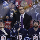 Winnipeg Jets coach Paul Maurice and players Mark Scheifele (55), Drew Stafford (12) and Andrew Ladd (16) look up at the replay of the Chicago Blackhawks' game-tying goal during the third period of an NHL hockey game Sunday, March 29, 2015, in Winnipeg, Manitoba. (AP Photo/The Canadian Press, John Woods)
