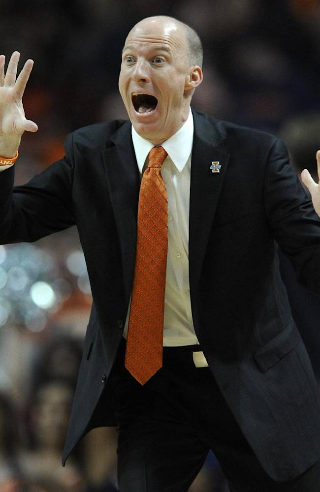 Illinois head coach John Groce yells to his players during the first half of an NCAA basketball game against Illinois-Chicago in Chicago, Saturday, Dec., 28, 2013. Illinois won 74-60