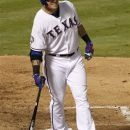 Texas Rangers' Josh Hamilton grimaces after striking out in the seventh inning of a baseball game against the Cleveland Indians, Wednesday, Sept. 12, 2012, in Arlington, Texas. Hamilton did not take the field in the eighth inning due to left knee soreness in the 5-2 Rangers win. (AP Photo/Tony Gutierrez)
