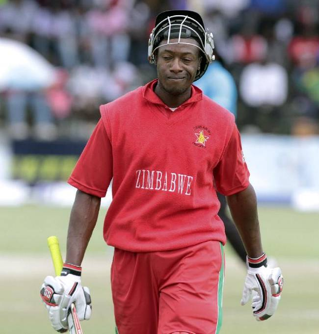 Zimbabwe batsman Vusimusi Sibanda walks off the pitch after been dismissed during the One Day International cricket match against South Africa in Harare, Zimbabwe, Thursday Sept. 4, 2014