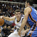 Memphis Grizzlies' Jon Leuer, left, drives in front of Oklahoma City Thunder's Nick Collison in the second half of an NBA basketball game in Memphis, Tenn., Wednesday, Dec. 11, 2013. The Thunder defeated the Grizzlies 116-100 The Associated Press